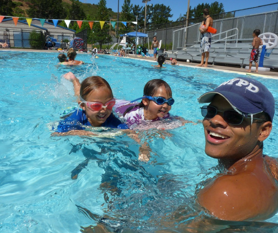 Campers learning to swim from their swim counselor