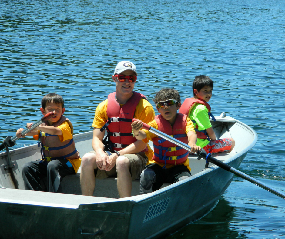 Campers rowing with their counselor on the Reservoir