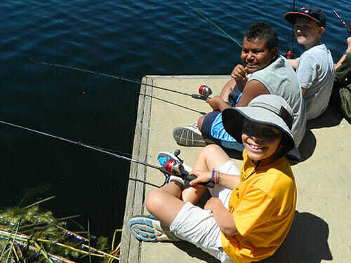 Young Campers Practice Fishing on the Docks