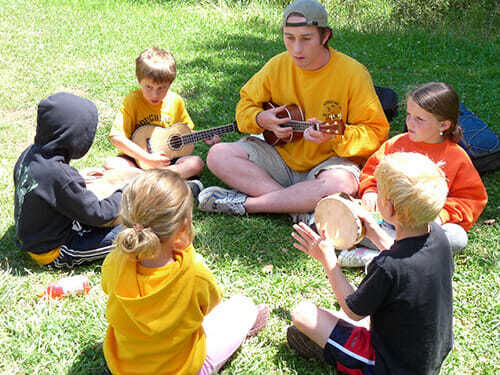 Young Campers Play Instruments as a Group at the Reservoir