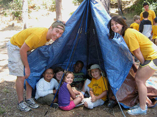 Young Campers Pitch a Tent in Outdoors