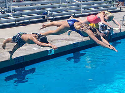 Teen Campers Dive into Deep Pool During Swimming