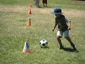 Camper learning new soccer skills at sports