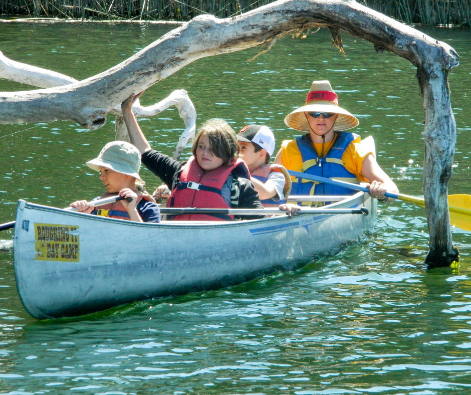 Campers traverse the Reservoir in a canoe