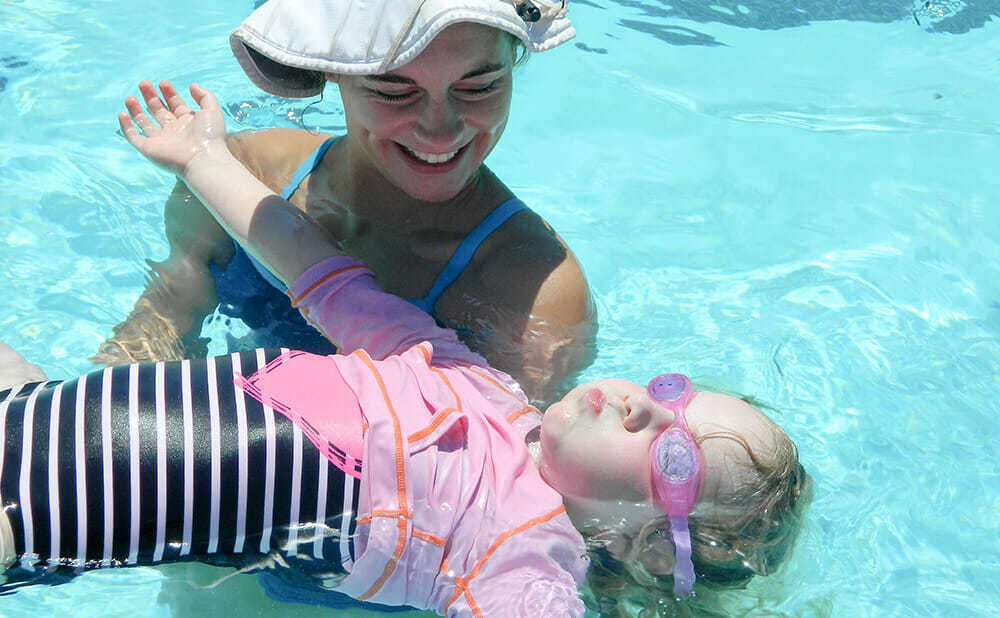 Young Camper Learns to Float in Swimming