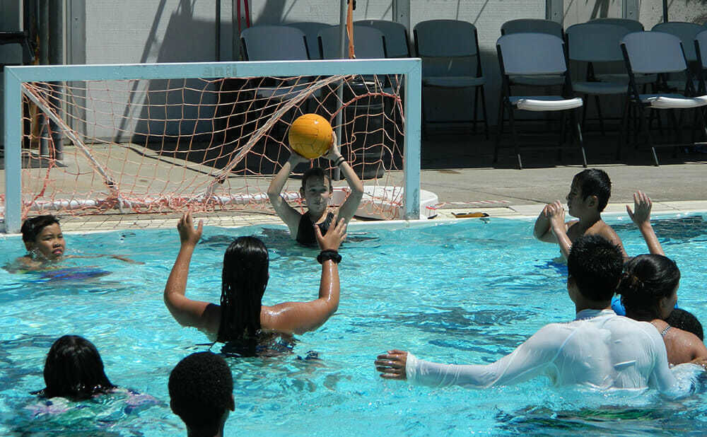 Teen Campers Play Water Polo at Swimming