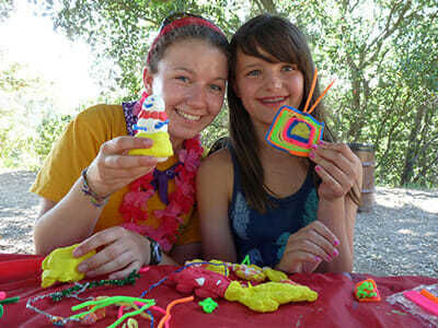 Teen Camper Shows off Clay Figure in Crafts