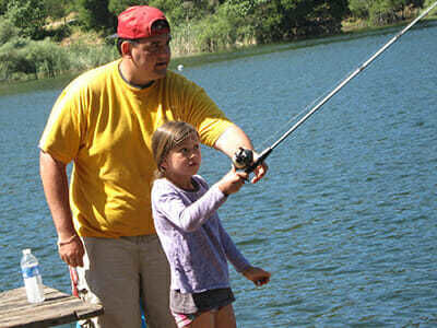 Girl Camper Learns to Cast in Fishing