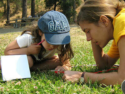 Young Camper Learns About Bugs in Environment