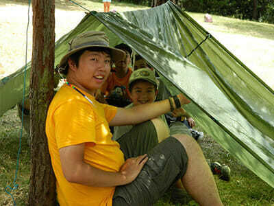 Boy Campers Pitch a Tent in Outdoors
