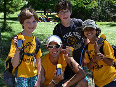Young Boy Campers Hold Geocaching Devices