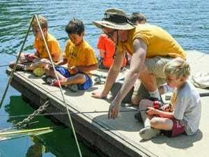 Young Boy Campers Learn to Fish
