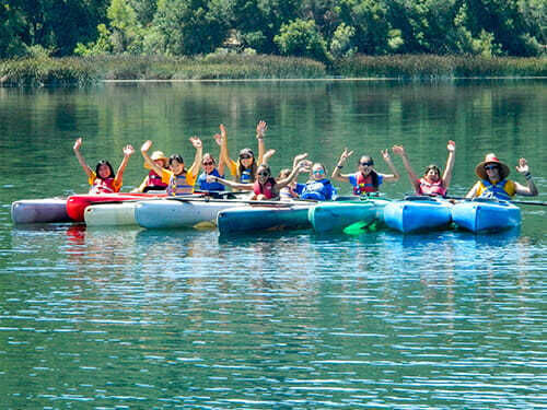 Tenn Campers Pose in Kayaks as a Group
