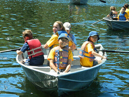 Young Campers Navigate their Rowboat in the Reservoir