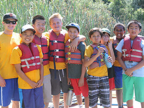 Preteen Boy Campers Stand Wearing PFDs