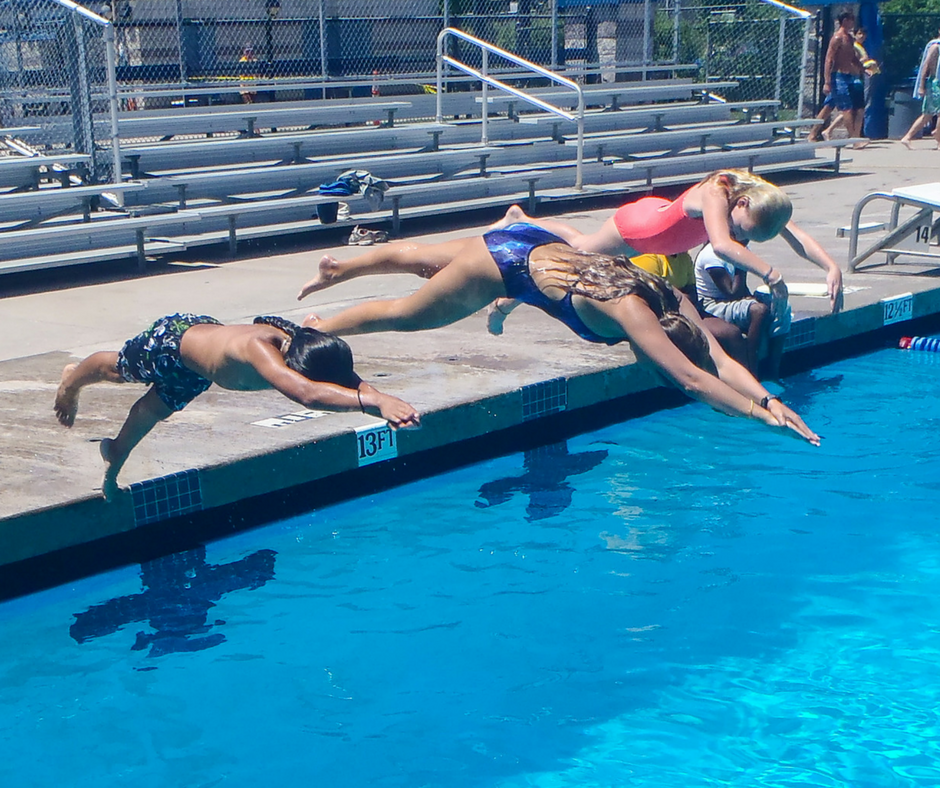Kids diving at swimming