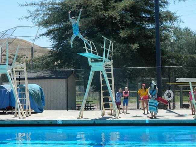 female camper ar roughing it day camp going off high dive