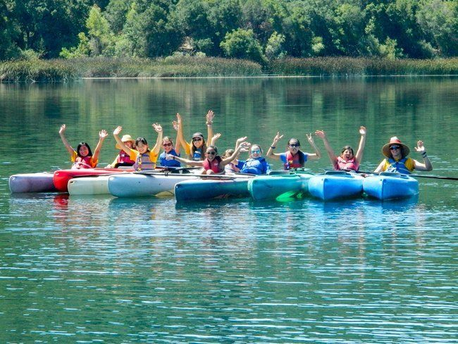 teen campers kayaking on waterfront at lafayette reservoir at roughing it day camp