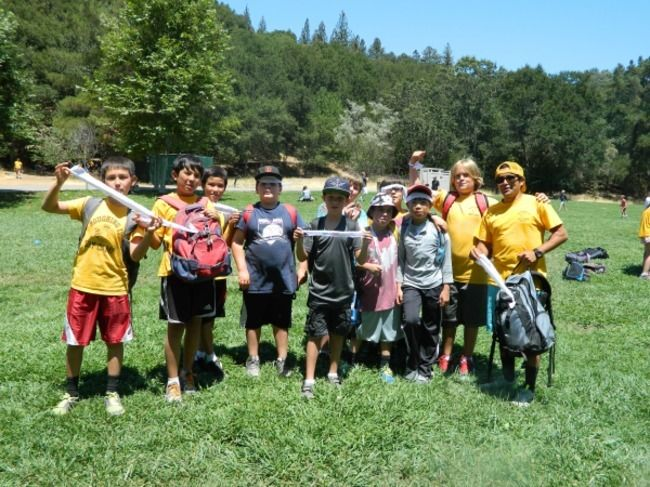 campers and counselors getting ready to get in boats on the water in the lafayette reservoir at roughing it day camp