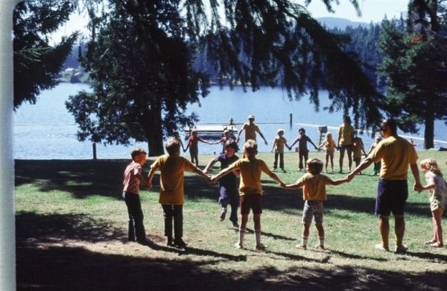 Campers standing in a circle holding hands.
