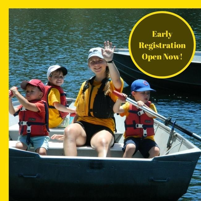 campers and counselor in row boat at Lafayette Reservoir with words early registration open now for roughing it day camp