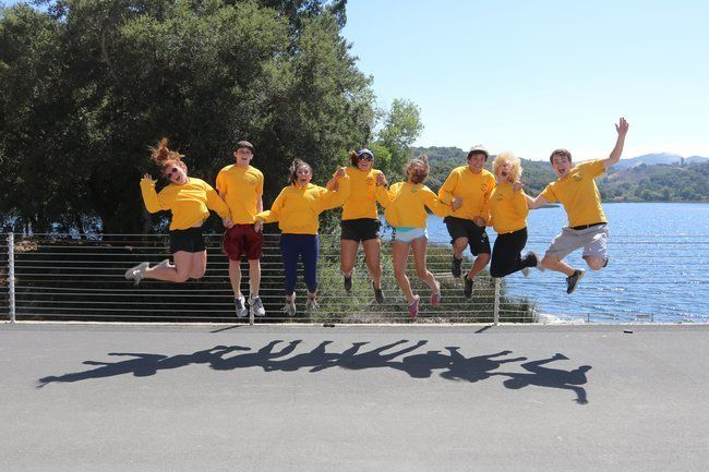 counselros at Roughing It Day Camp jumping for joy at the lafayette reservoir