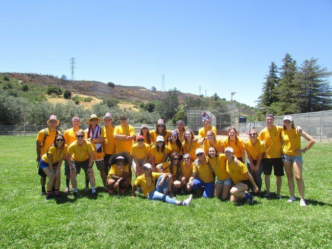 all counselors posing together on the fourth of july roughing it day camp family picnic