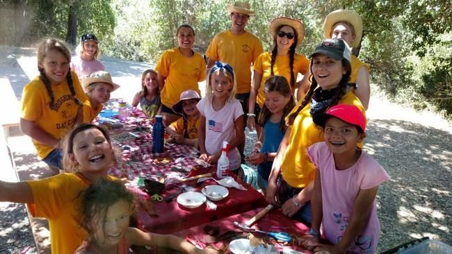 Campers and Counselors dressed up for western day, doing crafts at the Lafayette Reservoir
