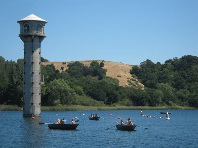 campers and counsleors row boating around the lafayette reservoir